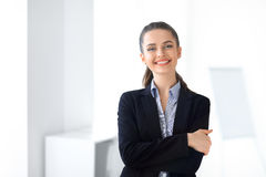 Portrait of young laughing business woman in the office Stock Images