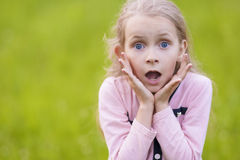 Portrait of young little blond girl exlaiming. Royalty Free Stock Photos