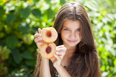Portrait of a young little girl with peach Stock Image