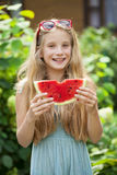 Portrait of a young little girl with watermelon Royalty Free Stock Photos