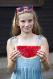 Portrait of a young little girl with watermelon. Portrait of a young blonde little girl with watermelon, summer outdoor Stock Photography