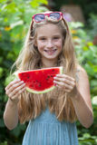 Portrait of a young little girl with watermelon. Portrait of a young blonde little girl with watermelon, summer outdoor Royalty Free Stock Photography