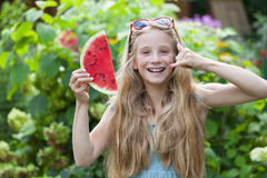 Portrait of a young little girl with watermelon Royalty Free Stock Image