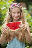 Portrait of a young little girl with watermelon. Portrait of a young blonde little girl with watermelon, summer outdoor Stock Images