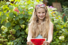 Portrait of a young little girl with watermelon. Portrait of a young blonde little girl with watermelon, summer outdoor Royalty Free Stock Image