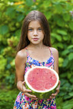 Portrait of a young little girl with watermelon. Portrait of a young brunette little girl with watermelon, summer outdoor Royalty Free Stock Image