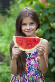 Portrait of a young little girl with watermelon. Portrait of a young brunette little girl with watermelon, summer outdoor Stock Images