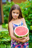 Portrait of a young little girl with watermelon. Portrait of a young brunette little girl with watermelon, summer outdoor Stock Photos
