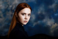Portrait of a young girl on dark background Royalty Free Stock Photos