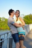 Portrait of a young in love couple on the bridge Stock Photos