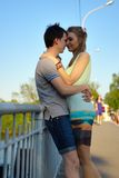 Portrait of a young in love couple on the bridge Royalty Free Stock Photo