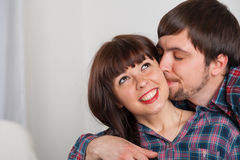 Portrait of young love couple at home. Kissing moments Stock Photo