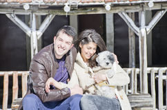 Portrait of a young love couple and their dog Royalty Free Stock Photo
