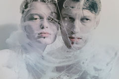 Portrait of young lovers. Entangled web of closeup Royalty Free Stock Image