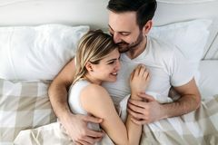 Portrait of young loving couple in bedroom Stock Photo