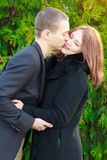 Portrait of young loving couple kissing in autumn park Stock Photo