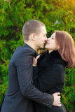 Portrait of young loving couple kissing in autumn park Stock Images