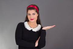 Portrait of maid in black uniform Stock Image