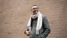 A portrait of young male african american business student puts on glasses smiling cheerful close up stock footage