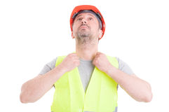 Portrait of young male builder fixing his protection equipment Stock Photos