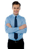Portrait of a young male business executive. Smiling male businessman with folded arms isolated on white background Stock Images