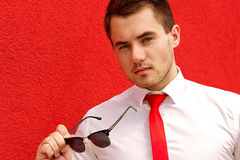 Portrait of a young male businessman in sunglasses stock images