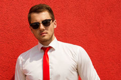 Portrait of a young male businessman in sunglasses stock image