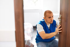 Portrait Young Male Carpenter Repairing Door Lock Stock Photography