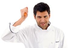 Portrait of young male chef holding dagger Stock Images