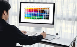 Portrait of young male designer, Freelance working with colors a Stock Photo