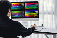 Portrait of young male designer, Freelance working with colors a Royalty Free Stock Photo