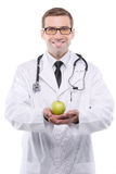 Portrait of young male doctor holding green apple. Stock Image