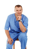 Portrait of a young male doctor in a medical surgical blue unifo Royalty Free Stock Image