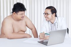 Doctor showing a medical result to his patient Stock Photo