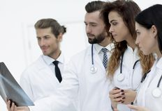 Portrait of young male doctors looking at x-ray Royalty Free Stock Photography
