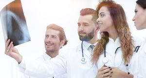 Portrait of young male doctors looking at x-ray Royalty Free Stock Photo