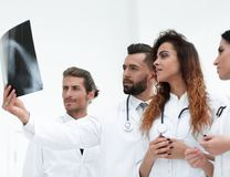 Portrait of young male doctors looking at x-ray Royalty Free Stock Image