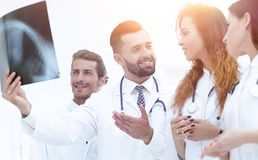 Portrait of young male doctors looking at x-ray Stock Image