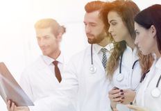 Portrait of young male doctors looking at x-ray Stock Photography