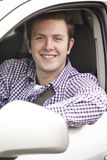 Portrait Of Young Male Driver Looking Out Of Car Window Stock Photography