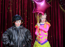 Portrait of Young Male and Female Clowns on Stage Royalty Free Stock Images