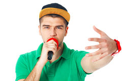 Portrait of young male hip hopper  singing in studio isolated on Stock Photography