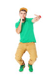 Portrait of young male hip hopper  singing in studio isolated on Royalty Free Stock Photography