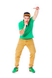 Portrait of young male hip hopper singing in studio isolated on Stock Image