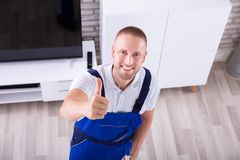 Portrait Of A Young Male Janitor. Portrait Of A Happy Male Janitor Standing In Living Room stock image