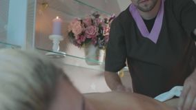 Portrait of young male maasagist at work in luxury spa salon. stock footage