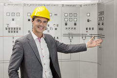 Portrait of young male manager gesturing in control room Stock Images