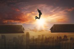 Young manager leaping above the bridge Stock Image