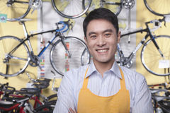 Portrait of young male mechanic in bicycle store, Beijing Royalty Free Stock Image