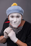 Portrait of young male mime with white face, grey Stock Images